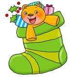 Bear in christmas sock. Happy toy bear in a big christmas sock with other present Stock Photography