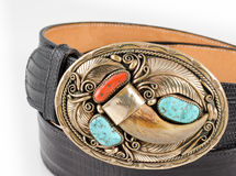 Bear Claw and Turquoise Belt Buckle. Gold, Bear Claw, Turquoise and Coral Belt Buckle with Snakeskin Belt Royalty Free Stock Photo