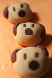 Bear cookies. Three brown bear cookies placed on orange table cloth Stock Photography