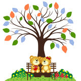 Bear Couple in love sitting on a bench under a tree at the park Stock Photo