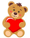 Bear cub holding a heart with love Stock Photo