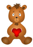 Bear cub sitting with heart Royalty Free Stock Image