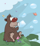 Bear cub and soap bubbles cartoon Royalty Free Stock Image