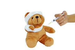 Bear doll are being injected. Royalty Free Stock Photography