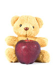 Bear doll give red apple. Bear doll give fresh red apple on white Stock Image