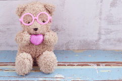 Bear Doll Holding Pink Heart Shape Stock Photos
