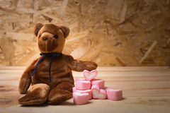 Bear doll with marshmallow heart. Royalty Free Stock Photography