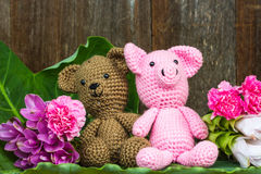 Bear doll and pig doll with flowers Stock Images