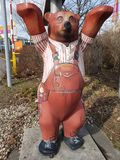 Bear a doll at the railway crossing Stock Photo