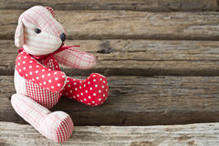 Bear doll on wood Royalty Free Stock Images