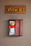 Bear doll in a wooden box Royalty Free Stock Image