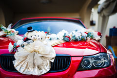 Bear dolls and flower decoration on car Royalty Free Stock Images