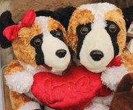 Bear dolls in love. Bear dolls to hold red love heart pillow Royalty Free Stock Image