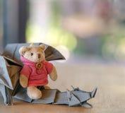 A bear and a dragon. A cute model bear and a origami dragon, a knight and a magic dragon concept Stock Photos