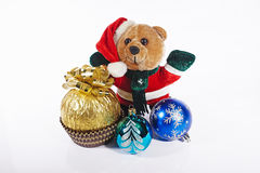Bear dressed as Santa Claus with gift and Christmas decorations Royalty Free Stock Images