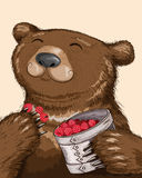 Bear eating raspberries. Funny bear eating raspberries from basket Royalty Free Stock Image