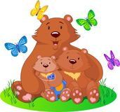 Bear_family. Mother bear sits on a meadow with the cubs Stock Photo