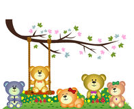 Bear family playing under tree branch in the park Stock Photos