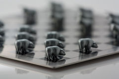 Bear figures. The photo shows the metal figures of bears and checkerboard Stock Photography