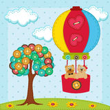 Bear flies on a balloon   near with tree from  of  Royalty Free Stock Photo