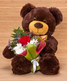 Bear with floral bouquet Royalty Free Stock Photography