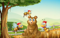 A bear at the forest with three Santa bees stock illustration
