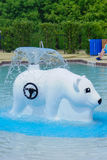 Bear fountain in a water park Stock Images