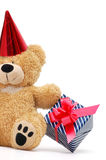 Bear with gift box. Teddy bear with gift box isolated on white Royalty Free Stock Photography
