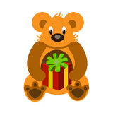 Bear. The bear with a gift in the clutches of a Packed box with a festive bow Royalty Free Stock Photography