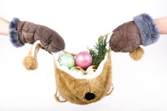 Bear hat filled with Christmas decorations Royalty Free Stock Photos