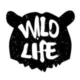Bear head silhouette with text wild life. Lettering style. Vector icon Royalty Free Stock Images