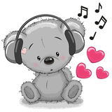 Bear with headphones Royalty Free Stock Images