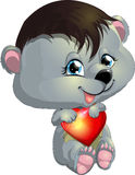 Bear and heart. The bear cub gently holds a heart royalty free illustration