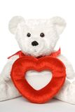 Bear with Heart Frame 003. White teddy bear holding heart shaped picture frame. Close up stock photography