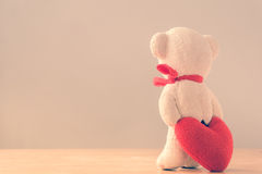 Bear with Heart on wood table Royalty Free Stock Photo