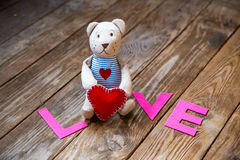 Bear with heart. On  wooden background Stock Photography