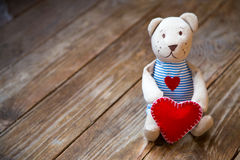 Bear with heart. On  wooden background Royalty Free Stock Images