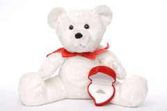 Bear Holding Engagement Ring 001. White teddy bear with engagement ring in heart shaped ring box stock photos
