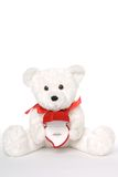 Bear Holding Engagement Ring 004. White teddy bear with engagement ring in heart shaped ring box royalty free stock photo