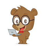 Bear holding a laptop. Clipart picture of a bear cartoon character holding a laptop Royalty Free Stock Photography