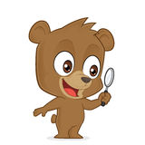 Bear holding a magnifying glass. Clipart picture of a bear cartoon character holding a magnifying glass Royalty Free Stock Image