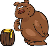 Bear and honey Royalty Free Stock Image