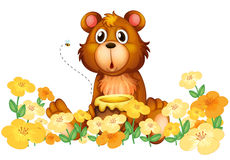 A bear with a honey at the garden Stock Image