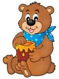 Bear with honey theme image 1 Stock Images