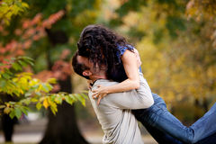Bear Hug. A man giving a woman a big hug in a park royalty free stock images