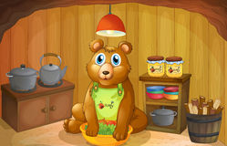 A bear inside the kitchen Stock Photo