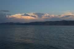 Bear Lake at Sunset. The sky was a rosy pink color and the water was rushing against the shore Royalty Free Stock Photo