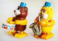 Bear, lion, drums and blowing saxophone , marching band wind up toy / Isolated white royalty free stock photo