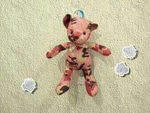 Bear. A lony little bear has a Doramon behide it Stock Photos