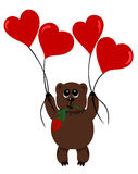 Bear in love. With flower flying on air-balloons attached to string Stock Photography